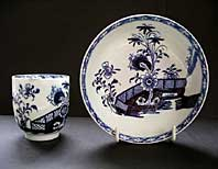 LOWESTOFT PORCELAIN RARE BLUE AND WHITE SCROLL HANDLE COFFEE CUP & SAUCER CHINESE GARDEN SCENE PATTERN C.1770-1780 front