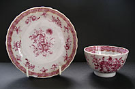 CHINESE EXPORT PORCELAIN TEABOWL AND SAUCER DECORATED IN ENGLAND WITH CARMINE FLORAL WORKSHOP OF JAMES GILES STYLE PATTERN C.1755-65
