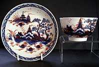 antique pottery image - LIVERPOOL PORCELAIN RICHARD CHAFFERS BLUE AND WHITE IMARI TEABOWL AND SAUCER WITH CANNONBALL PATTERN LANDSCAPE C.1760