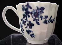 EARLY WORCESTER BLUE AND WHITE WORKMAN'S MARK FLUTED COFFEE CUP, THE PRUNUS ROOT PATTERN BFS I.D.27 C.1756