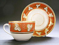 NEW HALL STAFFORDSHIRE RARE ORANGE GROUND BUTE SHAPE TEACUP AND SAUCER - PATTERN 508 C.1790-95