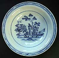 antique blue and white pottery image - AN ENGLISH DELFTWARE TINGLAZED DEEP DISH AFTER A DESIGN BY JEAN PILLEMENT C. 1760-65