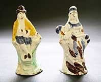 A PAIR OF EARLY STAFFORDSHIRE POTTERY PRATTWARE TOY FIGURES THE FARMER AND WIFE C.1795-1815