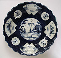 antique pottery image - RARE FIRST PERIOD WORCESTER BLUE AND WHITE POWDER BLUE GROUND PLATE - FAN PANELLED LANDSCAPE PATTERN BFS I.B. 27 C.1770-80